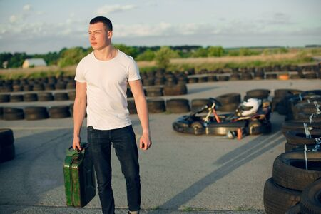 Handsome man in a karting with a car Фото со стока