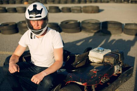 Handsome man in a karting with a car Stock fotó