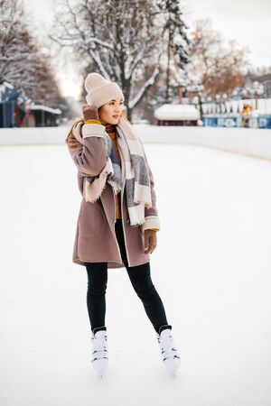 Cute and beautiful girl in a winter city