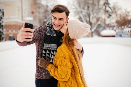 Cute couple in a winter city