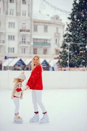 Cute and beautiful family in a winter city