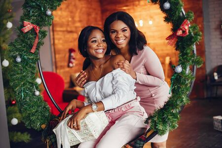 Elegant black girls in the Christmas decorations