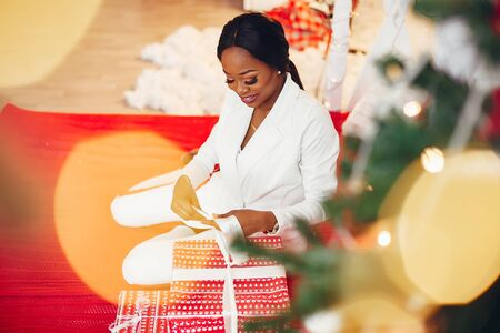 Elegant black girl in the Christmas decorations 스톡 콘텐츠