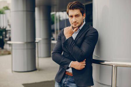 Handsome businesman in a summer city 版權商用圖片