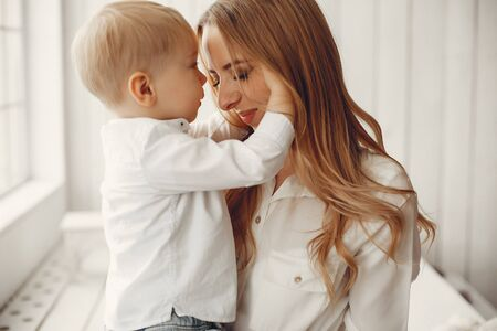 Mother with little son in a room Stock Photo - 137305554