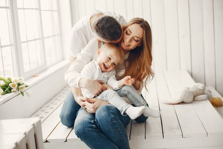 Cute and big family sitting at home Stock Photo - 137216047