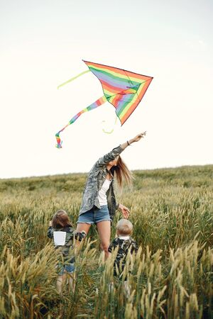 Mother with two children. Family with a Kite. Brother with a little sister