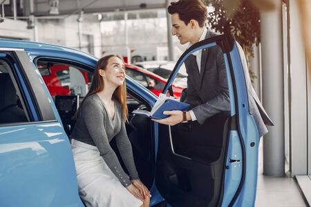 Two stylish woman in a car salon Reklamní fotografie