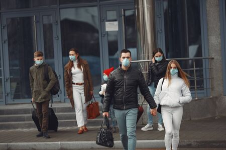 Travelers leaving airport are wearing protective masks