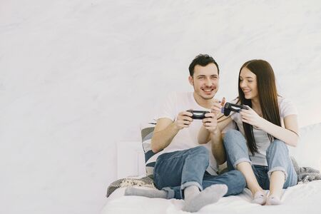 Couple at home playing in a video games