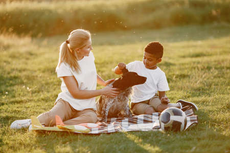 Multi-racial family playing in a summer park