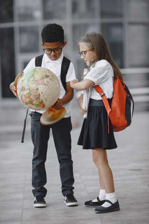 Little african boy study with caucasian girl