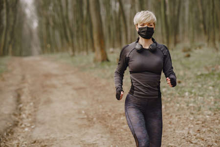 Masked woman training during coronavirus