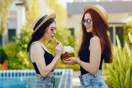 two girls drinking coconut juice