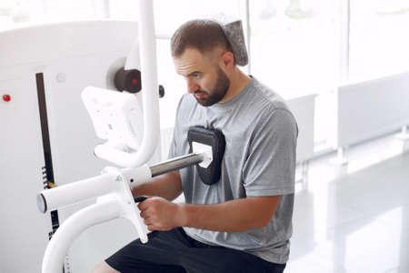 Bearded man having rehabilitation after injury in physiotherapy clinic