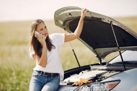 Woman near broken car call for help