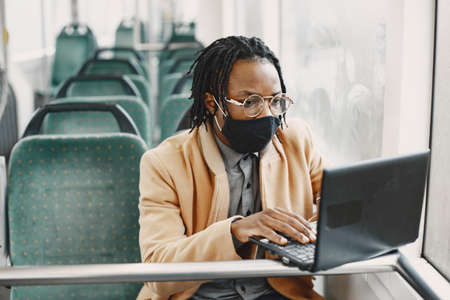 Young African businessman sitting in a bus
