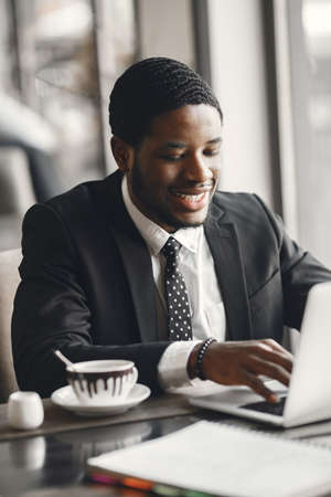 Man sitting at the computer and drinking coffee