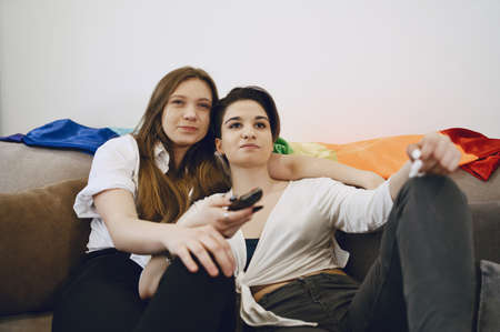 Lesbian girls to hug on couch and reveal TV