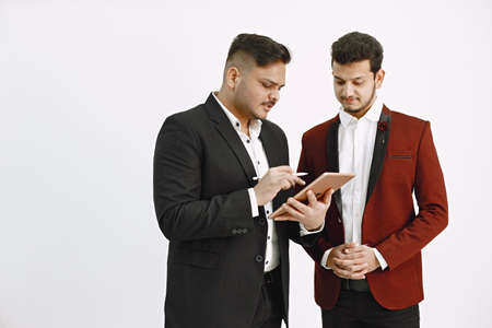 Two men in official costumes discussing something isolated
