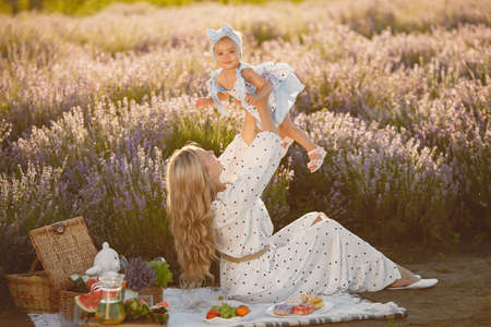 Little girl with her mother in a lavender field