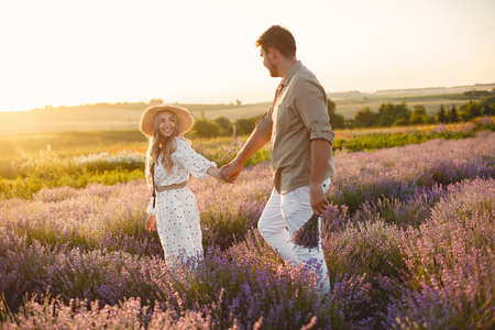 Woman in a white dress with her husband in a lavender field