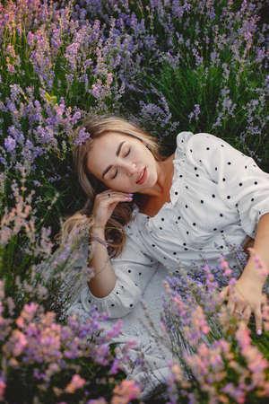 Woman in a white dress in a lavender field