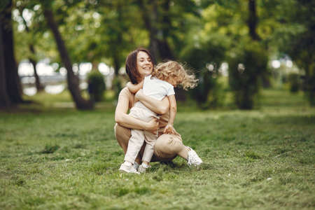Elegant mother with daughter in a summer forest Banque d'images