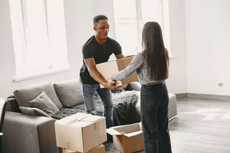 Couple unpacking boxes at their new home