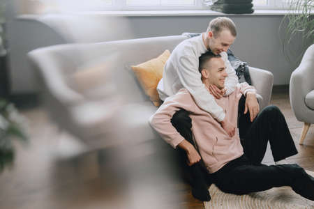 Young romantic gay couple spending day cuddling
