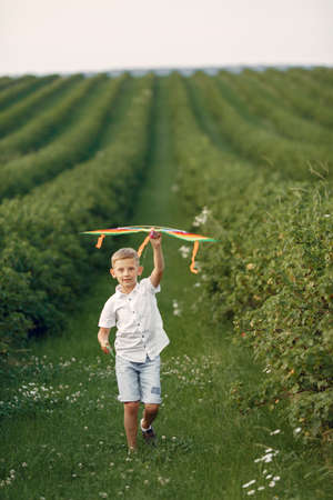 Excited little boy running with a toy plane