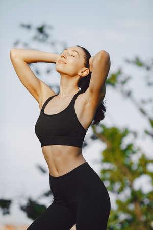 Woman practicing advanced yoga in a summer park 版權商用圖片