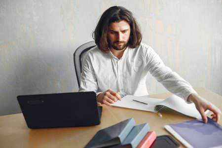 Stylish young businessman working with documents 版權商用圖片