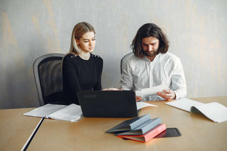 Stylish businessman with woman working at the office 版權商用圖片