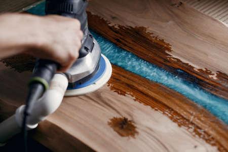 Man is processing with wood by polishing machine 版權商用圖片