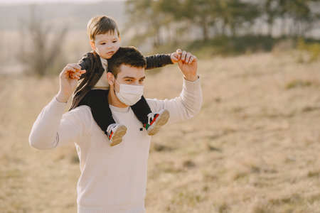 Father with little son in a masks