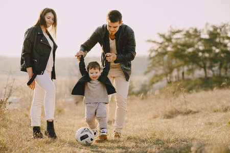 Stylish family walking on a spring field