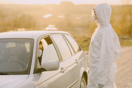Person in a protective suit checks the temperature 版權商用圖片