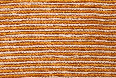 tightly: Macro of White, yellow and brown tightly woven fabric texture background