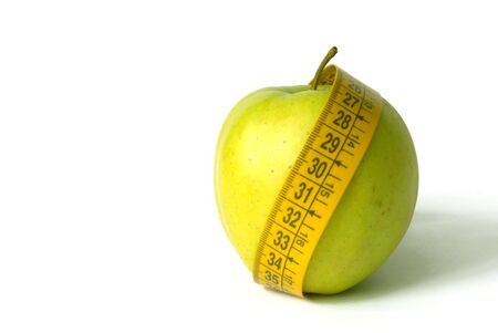 metre: Green Apple with tape metre isolated over white