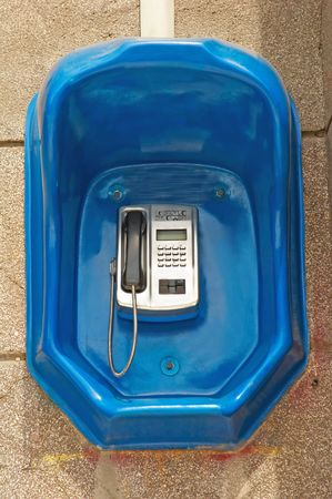 Street telephone on the building wall photo