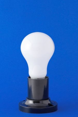 White bulb on the blue background Stock Photo - 3931365
