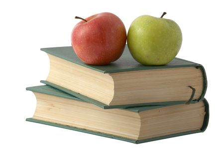 Two apples on the books with green cover isolated over white