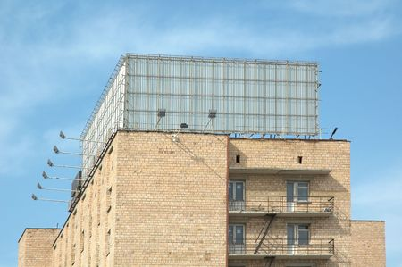 Billboard is a huge space. Brick building wall photo