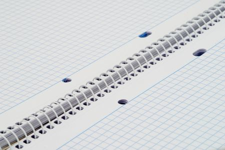 college ruled: Spiral notebook with blue grid. Selective focus