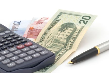 Business background with banknotes, calculator and fountain pen. Selective focus photo