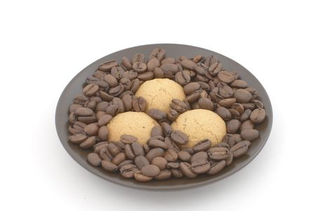Brown saucer with three biscuits and coffee beans  photo