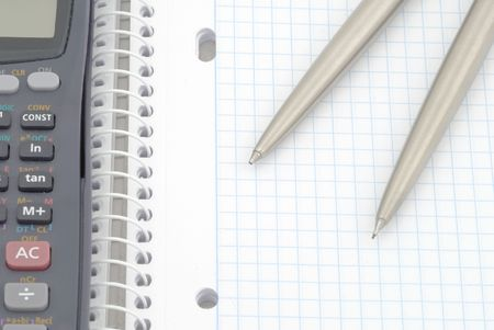 Business background. Spiral notebook with blue grid. Selective focus photo