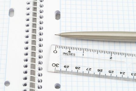 Business background with spiral notebook, pencil and ruler photo