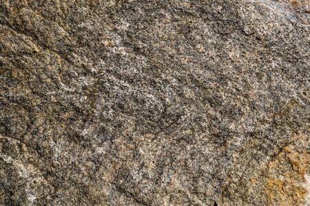 花崗岩の表面。石の質感。粗い花崗岩の石の質感。